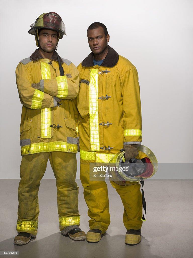 men in firefighting suits
