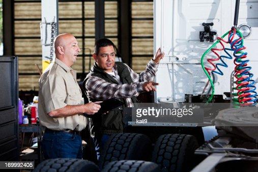 Men in garage with semi-truck