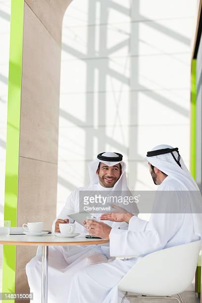 Men in kaffiyeh drinking coffee