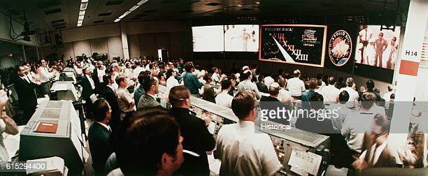 Men in Mission Control in Houston watch as the astronauts of the Apollo 13 mission are recovered by the USS Iwo Jima in the South Pacific Apollo 13...