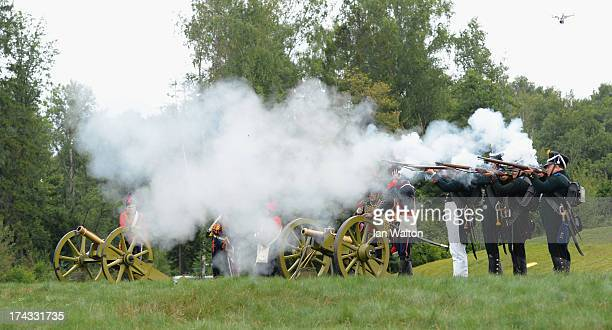 Men in period military costume fire cannons and muskets to start the Shotgun ProAm of the M2M Russian Masters at Tseleevo Golf Polo Club on July 24...