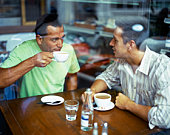 Men in restaurant with coffee