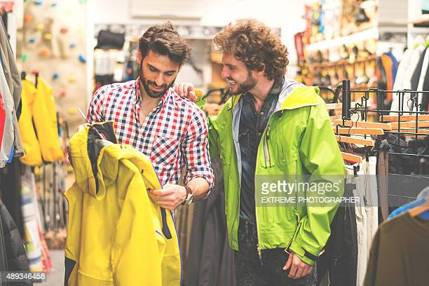 Men in sports and outdoor equipment store