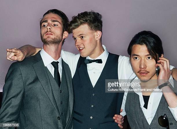 Men in suits talking in nightclub