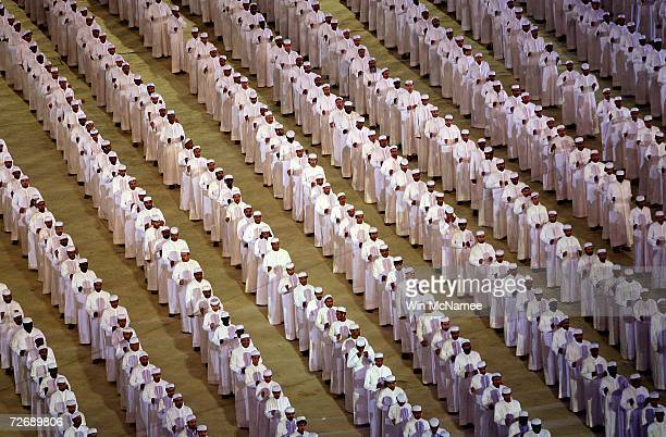 Men in traditional arabic dress perform during a rehearsal at Khalifa Stadium for the Opening Ceremony of the 15th Asian Games November 29 2006 in...