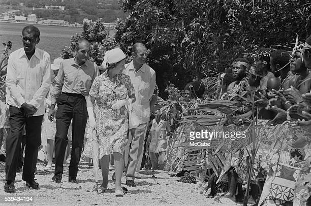 Men in traditional dress line the road during a visit by Queen Elizabeth and Prince Philip to Port Vila Vanuatu off the northeast coast of Australia...