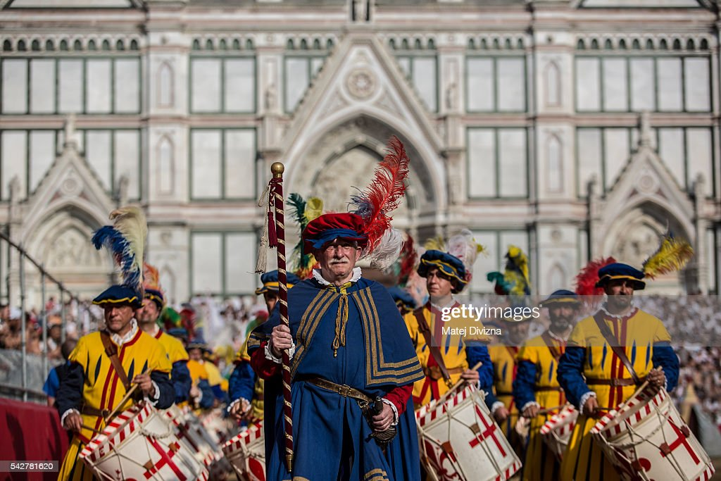 Men in traditional dress march before the final match of The Calcio Storico Fiorentino between the Santo Spirito Bianchi (White) Team and the La Santa Croce Azzuri (Blue) Team at the La Santa Croce square on June 24, 2016 in Florence, Italy. The Calcio Storico (Historical Football in English) Fiorentino is an early form of football, originating in the 1500's. It is a combination of football, rugby and wrestling. Now, annually during a weekend in early June, four teams representing the districts of Florence face each other in the first semi-finals. The winners go to the final, played every year on June 24, the day of the patron of Florence, St. John the Baptist. The official rules of calcio (football) were written for the first time in 1580 by Giovanni de Bardi, a count from Florence. The teams are formed by 27 players and the ball can be played either with hands or feet. Tactics such as punching, elbowing and all martial arts techniques are allowed but kicks to the are forbidden, as are fights of two or more against one. There is a referee, a field master, and six linesmen. The game lasts 50 minutes, and the winning team is the one who scores most points. The playing field is a giant sand pit with a narrow split constructing the goal running the width of each end. The Calcio Storico was not played for 200 years, until its revival in 1930.