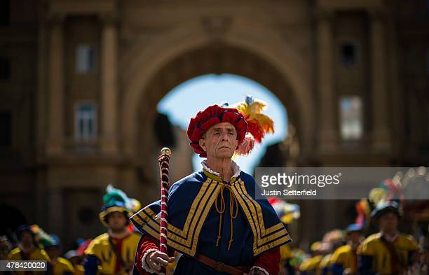 Men in traditional dress march through Florence ahead of the Calcio Storico Fiorentino 2015 final match between the Santo Spirito Bianchi Team and...