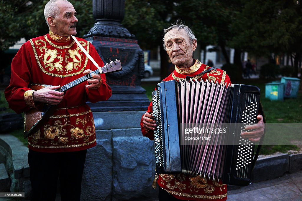 Men in traditional dress prepare to perform at a rally in support of the upcoming referendum on March 13, 2014 in Yalta, Ukraine. As the standoff between the Russian military and Ukrainian forces continues in Ukraine's Crimean peninsula, world leaders are pushing for a diplomatic solution to the escalating situation. Crimean citizens will vote in a referendum on 16 March on whether to become part of the Russian federation.