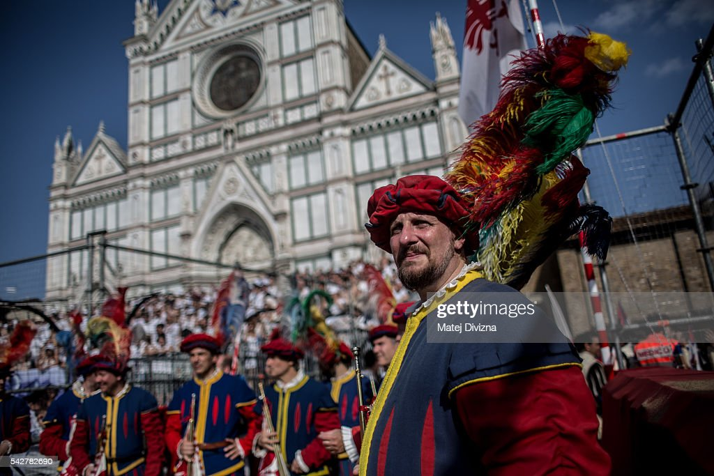 Men in traditional dress wait before the final match of The Calcio Storico Fiorentino between the Santo Spirito Bianchi (White) Team and the La Santa Croce Azzuri (Blue) Team at the La Santa Croce square on June 24, 2016 in Florence, Italy. The Calcio Storico (Historical Football in English) Fiorentino is an early form of football, originating in the 1500's. It is a combination of football, rugby and wrestling. Now, annually during a weekend in early June, four teams representing the districts of Florence face each other in the first semi-finals. The winners go to the final, played every year on June 24, the day of the patron of Florence, St. John the Baptist. The official rules of calcio (football) were written for the first time in 1580 by Giovanni de Bardi, a count from Florence. The teams are formed by 27 players and the ball can be played either with hands or feet. Tactics such as punching, elbowing and all martial arts techniques are allowed but kicks to the are forbidden, as are fights of two or more against one. There is a referee, a field master, and six linesmen. The game lasts 50 minutes, and the winning team is the one who scores most points. The playing field is a giant sand pit with a narrow split constructing the goal running the width of each end. The Calcio Storico was not played for 200 years, until its revival in 1930.