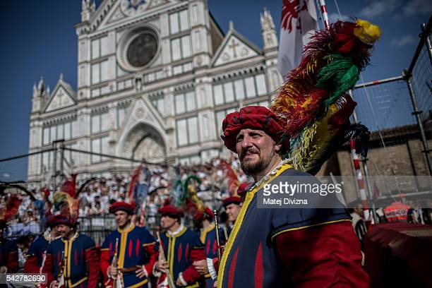 Men in traditional dress wait before the final match of The Calcio Storico Fiorentino between the Santo Spirito Bianchi Team and the La Santa Croce...