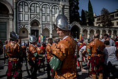 Men in traditional dress wait for march before the final match of The Calcio Storico Fiorentino between the Santo Spirito Bianchi Team and the La...