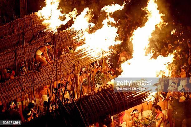 Men in traditional 'shimekomi' loincloths light six 13metrelong giant torches during the 'Oniyo' fire festival at Daizenji Tamataregu Shrine on...