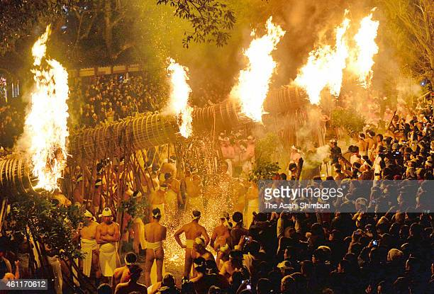 Men in traditional 'shimekomi' loincloths light six giant torches during the 'Oniyo' fire festival at Daizenji Tamataregu Shrine on January 7 2015 in...