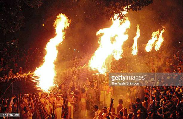 Men in traditional 'shimekomi' loincloths light six giant torches during the 'Oniyo' fire festival at Daizenji Tamataregu Shrine on January 7 2011 in...