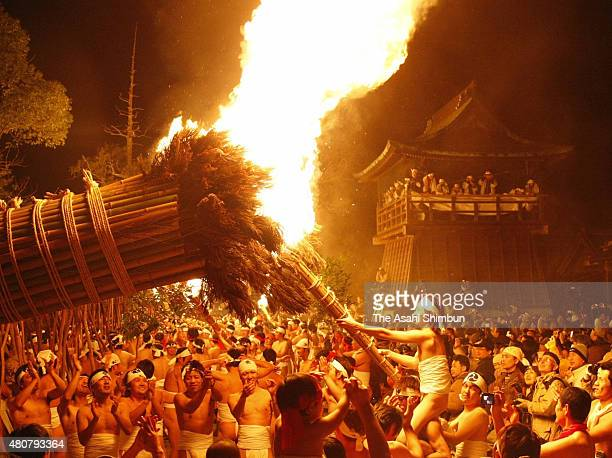 Men in traditional 'shimekomi' loincloths light six giant torches during the 'Oniyo' fire festival at Daizenji Tamataregu Shrine on January 7 2010 in...