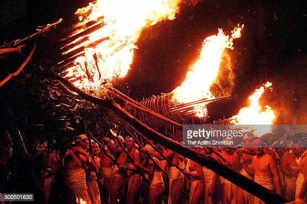 Men in traditional 'shimekomi' loincloths light six giant torches during the 'Oniyo' fire festival at Daizenji Tamataregu Shrine on January 7 2007 in...
