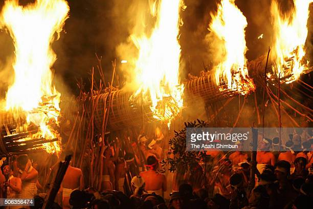Men in traditional 'shimekomi' loincloths light six giant torches during the 'Oniyo' fire festival at Daizenji Tamataregu Shrine on January 7 2005 in...