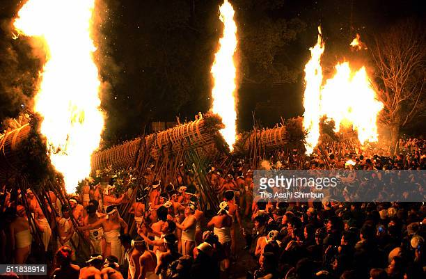 Men in traditional 'shimekomi' loincloths light six giant torches during the 'Oniyo' fire festival at Daizenji Tamataregu Shrine on January 7 2004 in...