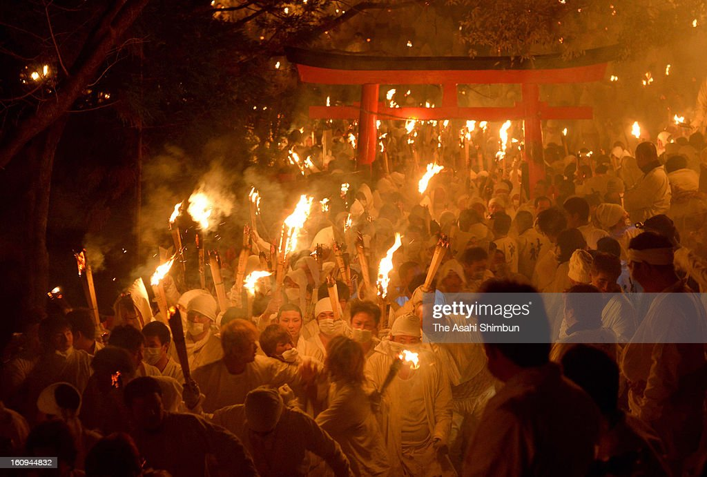 1,921 men in white costumes with flaming torches flood down the stone stairway during Oto Matsuri festival at Kamikura Shrine on February 6, 2013 in Shingu, Wakayama, Japan.