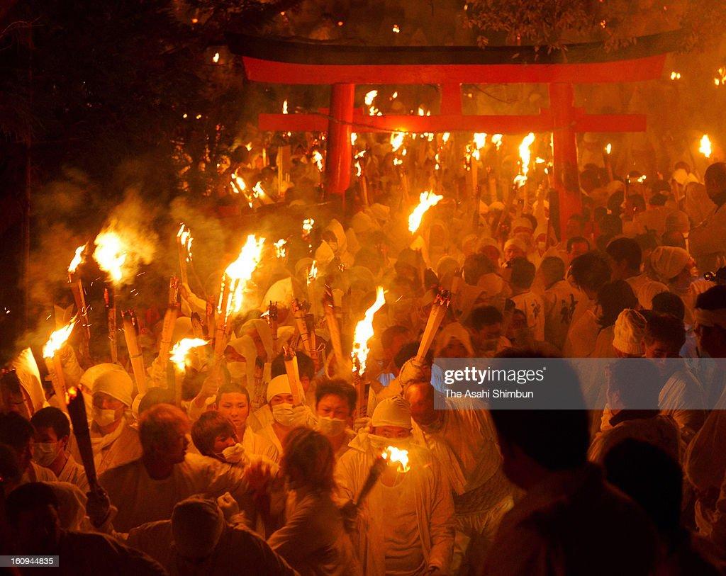1,921 men in white costumes with flaming torches flood down the stone stairway during Oto Matsuri festival at Kamikura Shrine on February 6, 2013 in Shingu, Wakayama, Japan.