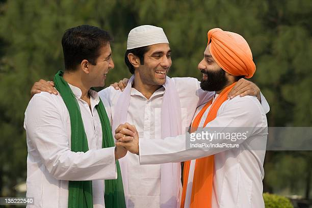 Men joining hands together