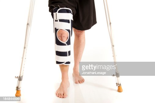 men knee after surgery with brace