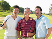 Men laughing on golf course