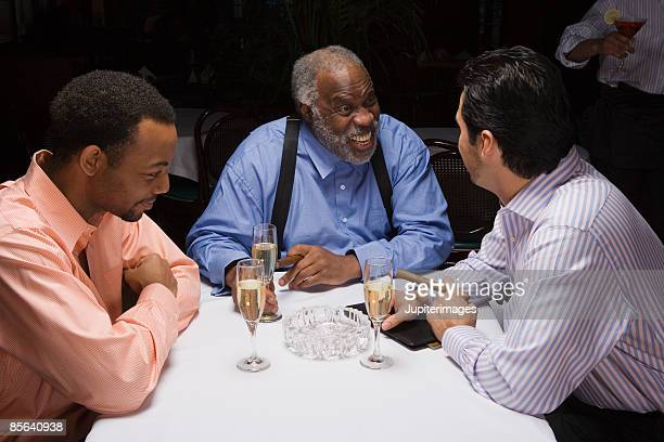Men laughing together at sophisticated nightclub