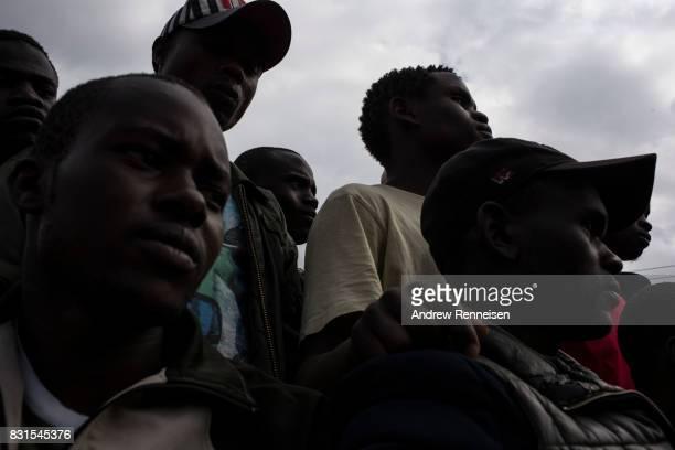 Men listen to local members of parliament speak regarding election fraud in the Lucky Summer neighborhood on August 14 2017 in Nairobi Kenya Nairobi...