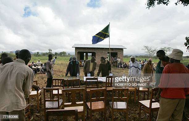 Men living in the Usa River village near Arusha Tanzania set up a table under a tree as they prepare to receive Princess Astrid of Belgium 03 October...