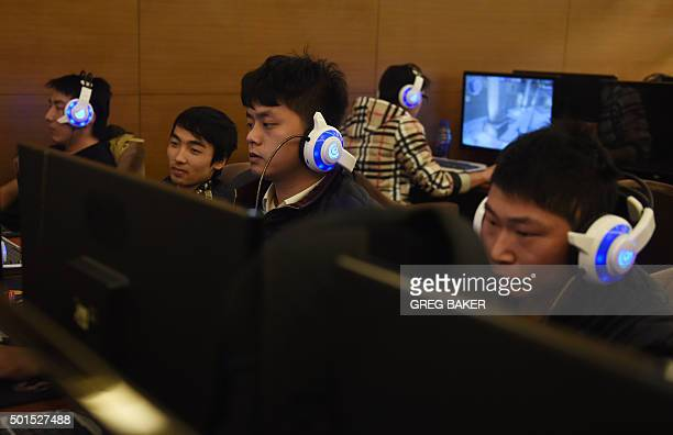 Men look at computers in an internet bar in Beijing on December 16 2015 'Freedom and order' are both necessary in cyberspace Chinese President Xi...