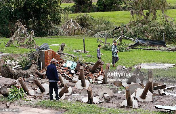 Men look at debris from homes destroyed after cyclonic winds on April 22 2015 in Dungog Australia Three people have died and more than 200000 are...