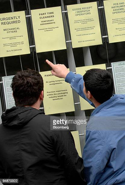 Men look at job vacancies in the window of an employment agency in Norwich UK on Saturday March 29 2008 UK unemployment fell less than economists...