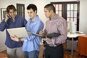 Men looking at laptop computer
