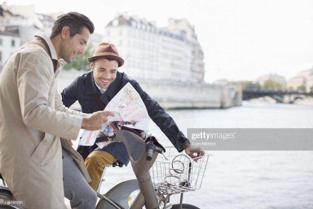 Men looking at map along Seine River, Paris, France : Stock Photo