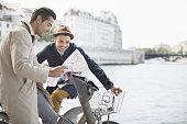 Men looking at map along Seine River, Paris, France