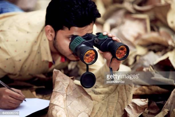 Men looking through binoculars