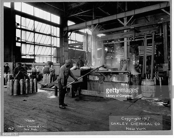 Men make munitions for World War I on the factory floor of Oakley Chemical Company