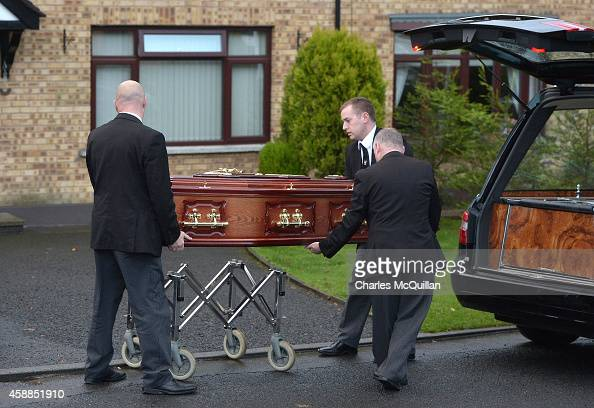 Men move a casket with the remains of Brendan Megraw known as one of 'The Disappeared' returns to his brother Kieran's home on November 12 2014 in...