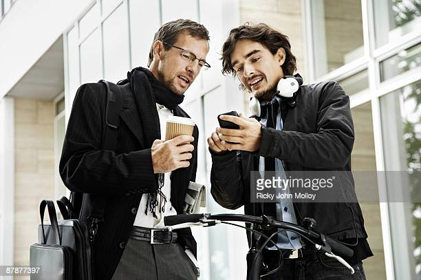 Men next to bicycle, coffee break