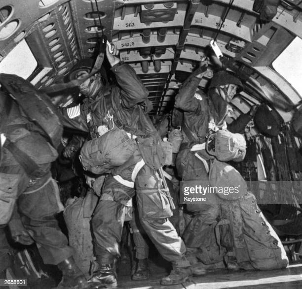 Men of the 17th US Airborne Division prepare to jump at Wesel on the Dutch border during the operation to secure the Rhine crossing Hungarianborn US...
