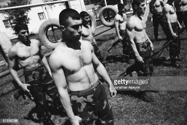 Men of the NKR Defense Army's 8th regiment wait to be called by pairs to practice close combat exercises May 10 2004 in Stepanakert NagornoKarabakh a...