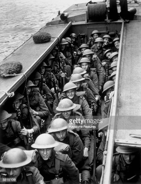 Men of the Royal Marines tucked away in the landing craft prepare to take part in invasion exercises