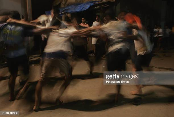 Men often form a huddle and break into a traditional jig locally known as 'gopalkalakhelne' a spontaneous form of dance once they successfully break...