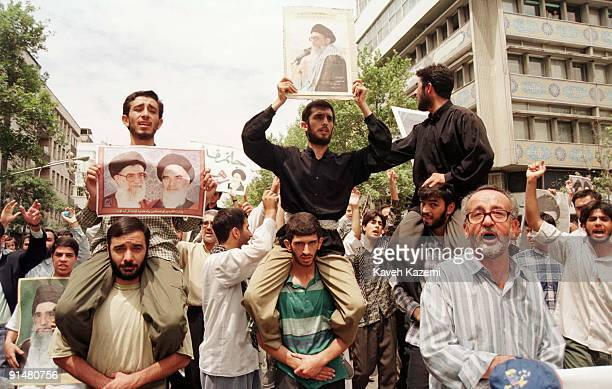 Men on a proleader demonstration in Tehran in support of Ayatollah Ali Khamenei after the city's student riots 14th July 1999 The riots caused huge...