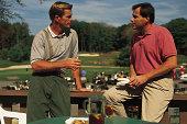 Men on balcony overlooking golf course