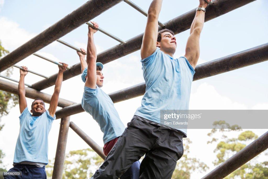 Men on monkey bars at boot camp