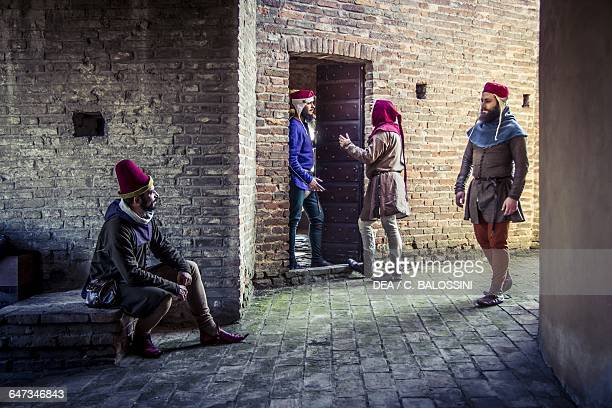 Men on the streets of Imola Italy mid14th century Historical reenactment