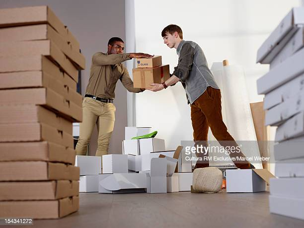 Men organizing messy work space
